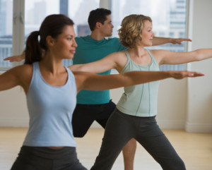 Multi-ethnic people in yoga class